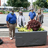The Leominster Rotary Club helped make the downtown look great by putting flowers and plants in 45 of the boxes around Monument Square. They have been doing this for over 50 years. Standing next to one of the boxes, made many years ago by the Shiver Job Corp, is, from left Past Presidents John Sauza, Clair Freda, John Tata  and President Christine Pelletier. SENTINEL & ENTERPRISE/JOHN LOVE