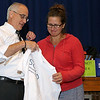 The Leominster School Department held an all district faculty function kicking off the new school year at the Leominster High School auditorium on Tuesday morning. Jen Mundie the PPS/Special Education teacher was one of two employees that got the Superintendents SOAR award at the function. Jen Mundie the PPS/Special Education teacher was one of two employees that got the Superintendents SOAR award at the function. Superintendent James R Jolicoeur recognizes her with a SOAR shirt. SENTINEL & ENTERPRISE/JOHN LOVE