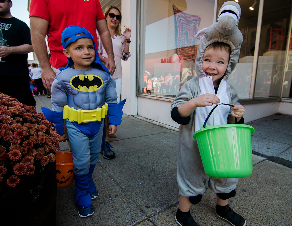 . Easton Nutter, 3, and Logan Nault, 4, enjoy the Leominster trick-or-treating on Saturday, October 21, 2017. SENTINEL & ENTERPRISE / Ashley Green