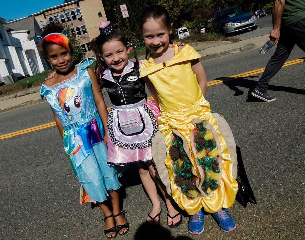 . Analeigha Tricoche, 7, Makayla Marlow, 7, and Breanna Calnan, 7, enjoy the Leominster trick-or-treating on Saturday, October 21, 2017. SENTINEL & ENTERPRISE / Ashley Green