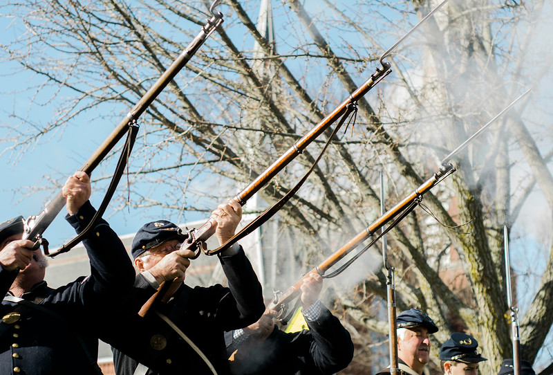 Members of the Leominster Veterans 15th Mass. Vol. Infantry give a rifle salute during the Veterans Day ceremonies on Leominster's Monument Square on Friday morning. SENTINEL & ENTERPRISE / Ashley Green