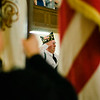 Veterans stand as the Color Guard enters the Veterans Day ceremony at Leominster City Hall on Friday morning. SENTINEL & ENTERPRISE / Ashley Green