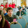 Patrick Mastriano, grandson of City Councilor Claire Freda, listens in during the Veterans Day ceremony at Leominster City Hall on Friday morning. SENTINEL & ENTERPRISE / Ashley Green
