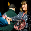 Wendy Wiiks hands out flags during the Veterans Day ceremonies on Leominster's Monument Square on Friday morning. SENTINEL & ENTERPRISE / Ashley Green