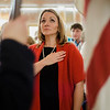 Jolene Constant stands as the Color Guard enters the Veterans Day ceremony at Leominster City Hall on Friday morning. SENTINEL & ENTERPRISE / Ashley Green