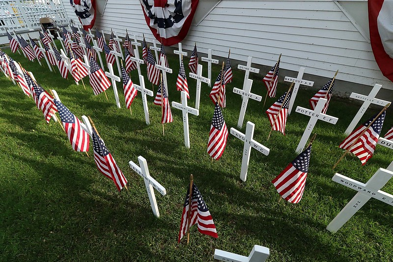 The White Cross Twilight Memorial Service was held at in front of the Leominster Veterans' Center on Friday night May 25, 2018. Each white cross represents a service member from Leominster that is missing-in-action, lost-at-sea, buried at sea or buried on foreign soil. Their remains have never returned home. SENTINEL & ENTERPRISE/JOHN LOVE