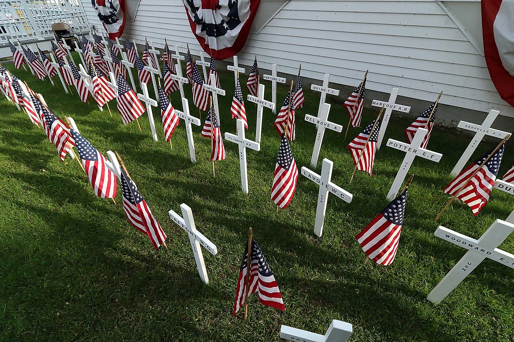 . The White Cross Twilight Memorial Service was held at in front of the Leominster Veterans\' Center on Friday night May 25, 2018. Each white cross represents a service member from Leominster that is missing-in-action, lost-at-sea, buried at sea or buried on foreign soil. Their remains have never returned home. SENTINEL & ENTERPRISE/JOHN LOVE