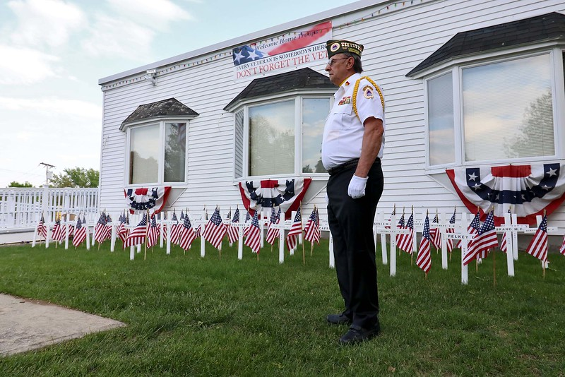 "The White Cross Twilight Memorial Service was held at in front of the Leominster Veterans' Center on Friday night May 25, 2018. Each white cross represents a service member from Leominster that is missing-in-action, lost-at-sea, buried at sea or buried on foreign soil. Their remains have never returned home. Calling out ""not present"" during the roll call was Commander of the VFW Tom Welch. SENTINEL & ENTERPRISE/JOHN LOVE"