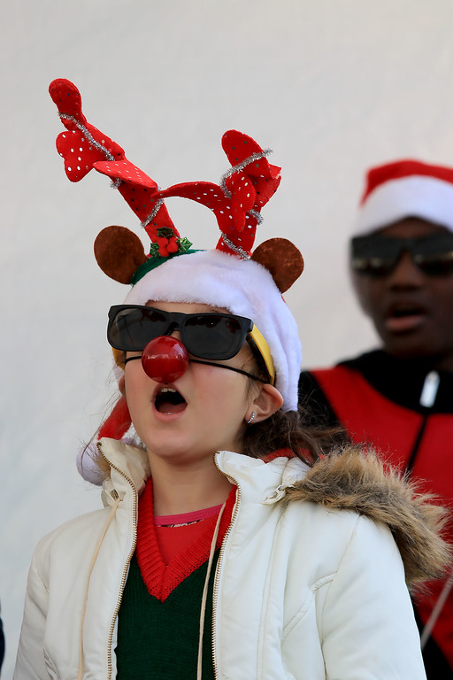 . The 13th Annual Leominster Holiday Stroll was held on on Saturday, December 1, 2018 in Downtown. The Fallbrook Songbirds entertained the crowd to start off the stroll. Fourth grader Isabelle Hofer sings with the Songbirds. SENTINEL & ENTERPRISE/JOHN LOVE