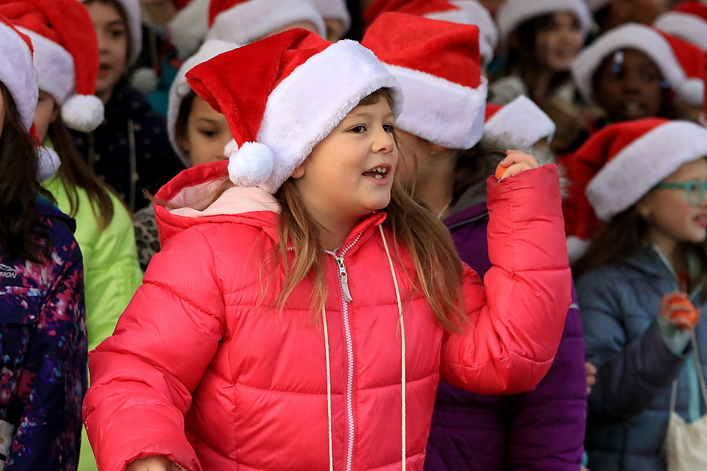 . The 13th Annual Leominster Holiday Stroll was held on on Saturday, December 1, 2018 in Downtown. The Fallbrook Songbirds entertained the crowd to start off the stroll. Third grader Makayla Muvaney sings with the Songbirds. SENTINEL & ENTERPRISE/JOHN LOVE