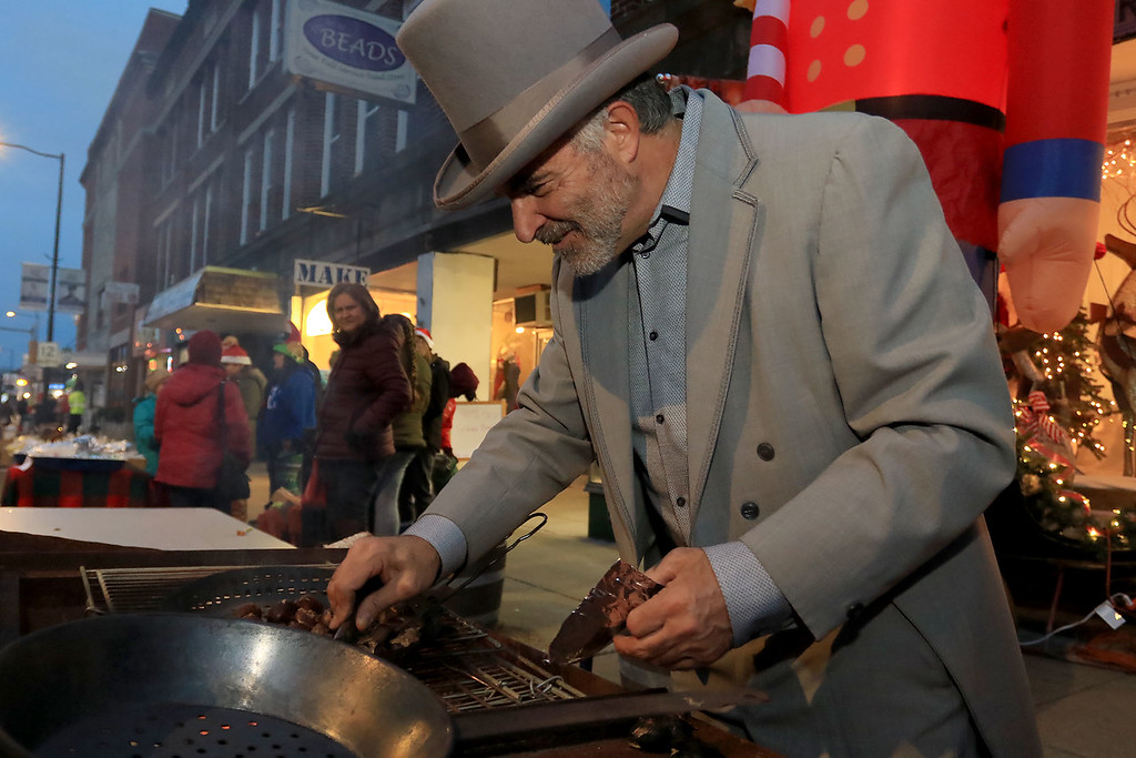 . The 13th Annual Leominster Holiday Stroll was held on on Saturday, December 1, 2018 in Downtown. All dressed up for the stroll Mayor Dean Mazzerella cooked up some chestnuts for everyone to try. SENTINEL & ENTERPRISE/JOHN LOVE