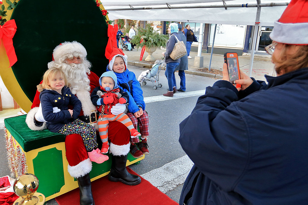 . The 13th Annual Leominster Holiday Stroll was held on on Saturday, December 1, 2018 in Downtown. Getting their picture with Santa is Savanah Weaver, 4, Bentley Weaver, 1, and Jonathan Weaver, 7. SENTINEL & ENTERPRISE/JOHN LOVE