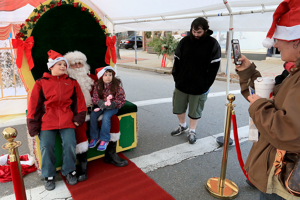 . The 13th Annual Leominster Holiday Stroll was held on on Saturday, December 1, 2018 in Downtown. Getting their picture with Santa is Savanah Weaver, 4, Bentley Weaver, 1, and Jonathan Weaver, 7. Joseph Saomala, 8, and Arieana Braman, 4. SENTINEL & ENTERPRISE/JOHN LOVE