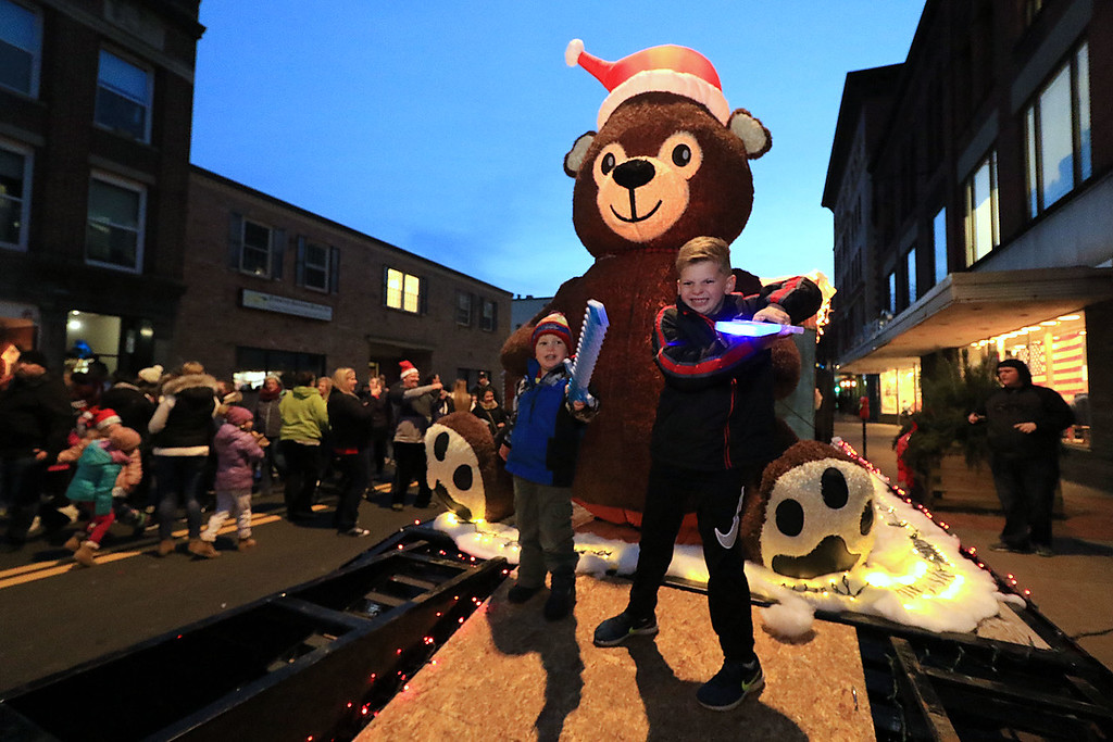 . The 13th Annual Leominster Holiday Stroll was held on on Saturday, December 1, 2018 in Downtown. Cooper, 6, and Liam Sheridan, 3, of Leominster pose for a picture next to a a big bear on the Polar Express  float on main street during the stroll. SENTINEL & ENTERPRISE/JOHN LOVE