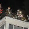 Firefighers perform overhaul on the roof<br /> SENTINEL&ENTERPRISE/Scott LaPrade