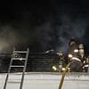Smoke and heavy charing can be seen a top this 2nd decking in Leominster 199 Prospect St SENTINEL&ENTERPRISE/Scott LaPrade