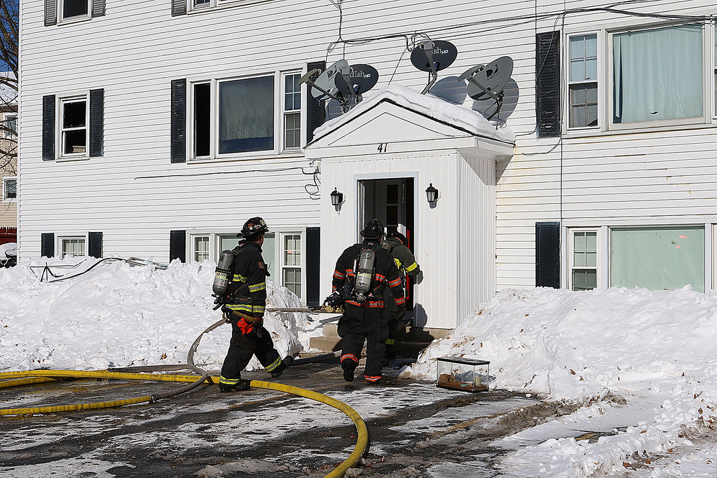 . Firefighters work on a fire that broke out on the second floor apartment of 41 Hamilton Street in Leominster on January 6, 2018. SENTINEL & ENTERPRISE/JOHNLOVE