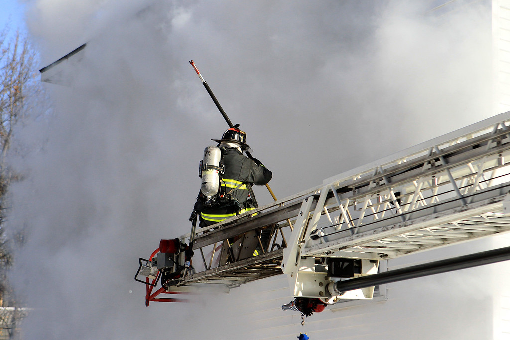 . Ff Vincent Alia works off the aerial at 41 Hamilton St SENTINEL&ENTERPRISE/Scott LaPrade