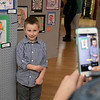The Leominster Youth Art show was held at the Tata Auditorium in City Hall Thursday, March 5, 2020. All the schools in the district participated. Luke Owens, 6, a Francis Drake Elementary School Kindergartener poses next to his piece in the show so his mom Mary Owens could take his picture. SENTINEL & ENTERPRISE/JOHN LOVE