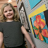 The Leominster Youth Art show was held at the Tata Auditorium in City Hall Thursday, March 5, 2020. All the schools in the district participated. Fall Brook Elementary School third grader Sydney Irwin's posed next to her flower piece in the show. SENTINEL & ENTERPRISE/JOHN LOVE