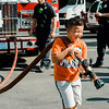 Juan Ruiz, 9, tests out a hose on one of the Leominster Fire Department trucks during the National Night Out event held at Watermill Apartments on Tuesday, August 1, 2017. SENTINEL & ENTEPRISE / Ashley Green
