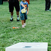 Kristofer Diaz, 5, plays a game of cornhole during the National Night Out event held at Lowe Park in Fitchburg on Tuesday, August 1, 2017. SENTINEL & ENTERPRISE / Ashley Green