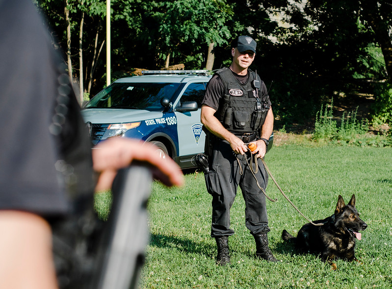 State Police Troopers Jeff Johnson puts on a demonstration with K9 drug detection dog Alex during the National Night Out event held at Lowe Park in Fitchburg on Tuesday, August 1, 2017. SENTINEL & ENTERPRISE / Ashley Green