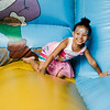 Aria George, 2, jumps on the bouncy house during the National Night Out event held at Lowe Park in Fitchburg on Tuesday, August 1, 2017. SENTINEL & ENTERPRISE / Ashley Green