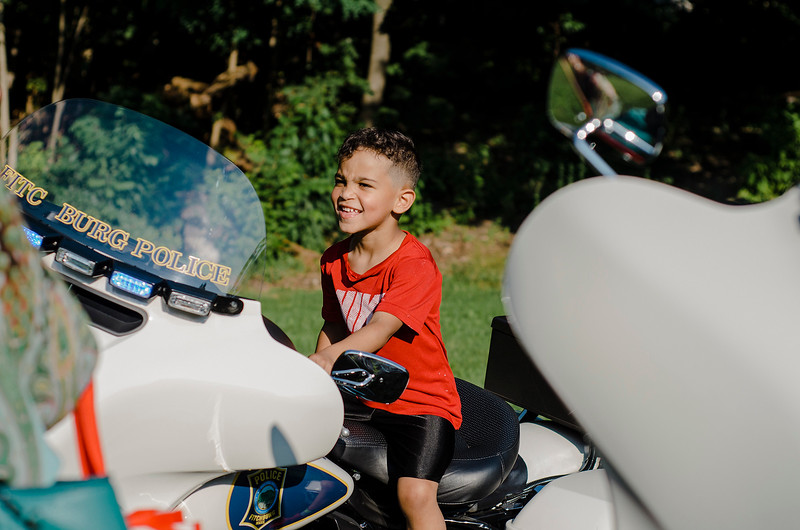 Julian Deleon, 4, tests out a Fitchburg Police Department motorcycle during the National Night Out event held at Lowe Park in Fitchburg on Tuesday, August 1, 2017. SENTINEL & ENTERPRISE / Ashley Green
