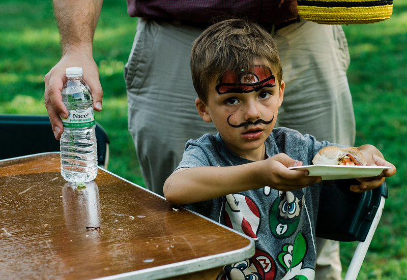 David Van Hazinga, 5, enjoys a sandwich during the National Night Out event held at Lowe Park in Fitchburg on Tuesday, August 1, 2017. SENTINEL & ENTERPRISE / Ashley Green
