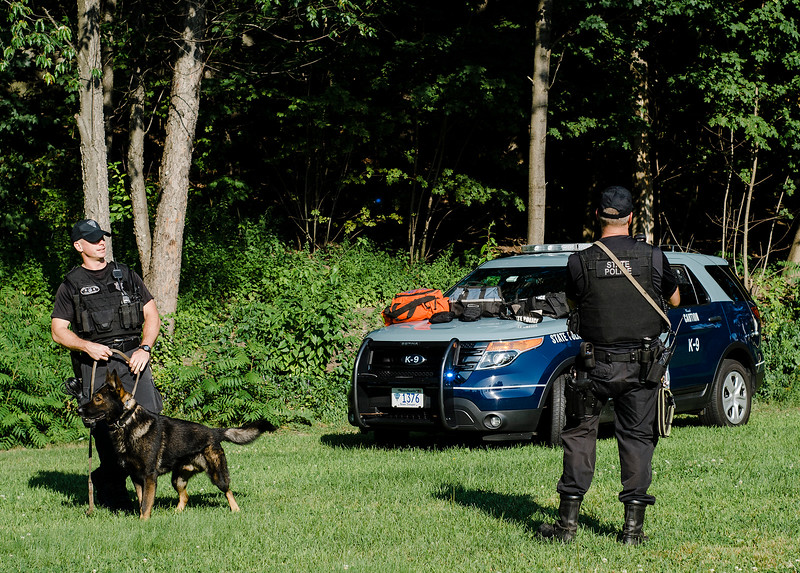 State Police Troopers Jeff Johnson and Brian Frechette put on a demonstration with K9 drug detection dog Alex during the National Night Out event held at Lowe Park in Fitchburg on Tuesday, August 1, 2017. SENTINEL & ENTERPRISE / Ashley Green