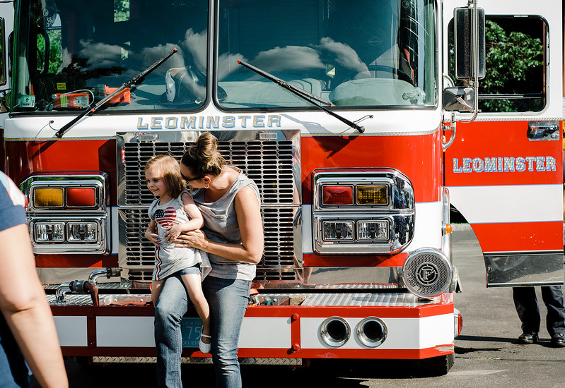 Emily Bergeron, 2, and her aunt Jen Smith check out one of the Leominster Fire Department trucks during the National Night Out event held at Watermill Apartments on Tuesday, August 1, 2017. SENTINEL & ENTEPRISE / Ashley Green