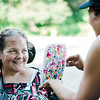 Sharon Patenaude gets her face painted by Nicole Kirrane, of Face Escape during the National Night Out event held at Lowe Park in Fitchburg on Tuesday, August 1, 2017. SENTINEL & ENTERPRISE / Ashley Green