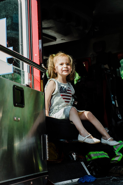 Emily Bergeron, 2, checks out one of the Leominster Fire Department trucks during the National Night Out event held at Watermill Apartments on Tuesday, August 1, 2017. SENTINEL & ENTEPRISE / Ashley Green