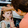Emily Bergeron, 2, gets her face painted by Brenda Piccard during the National Night Out event held at Watermill Apartments on Tuesday, August 1, 2017. SENTINEL & ENTEPRISE / Ashley Green