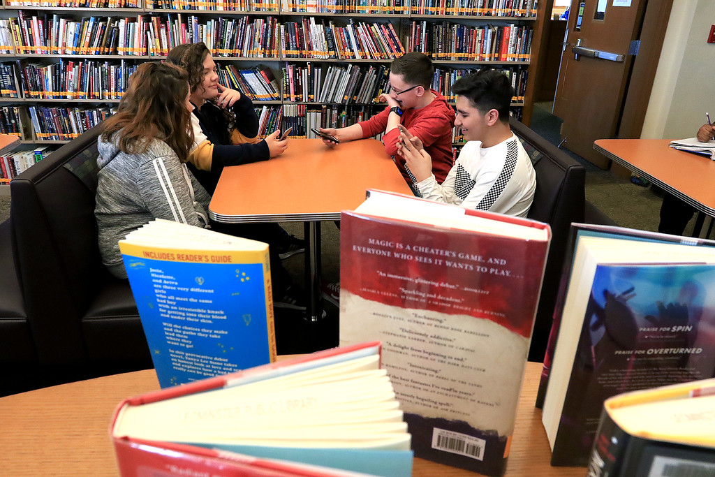 . Hanging out in the Leominster Public Library\'s teen room on Tuesday afternoon is, from left clockwise, Lailanii, 12, Ariana Paine, 13, Andy Brown, 13, and Reda Basalamah, 13. SENTINEL & ENTERPRISE/JOHN LOVE