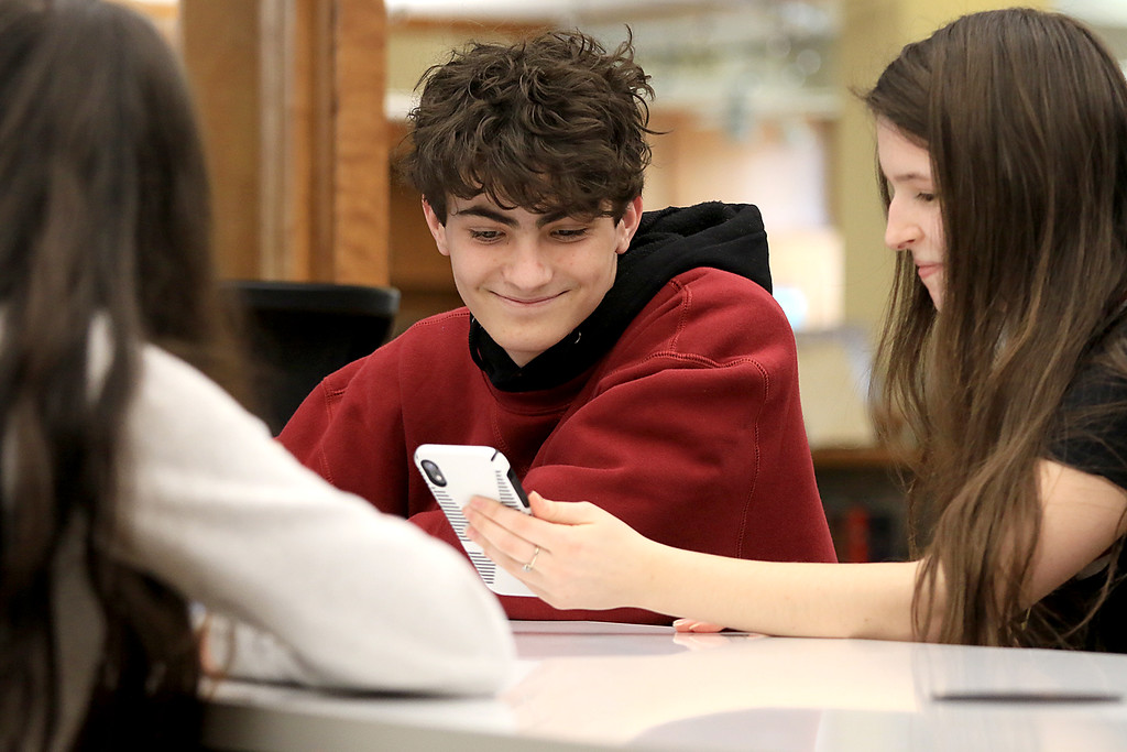 . Hanging out in the Lunenburg Public Library\'s teen room on Tuesday afternoon having fun with friends is Josh Thompson, 14, and Callie Dik, 15.  SENTINEL & ENTERPRISE/JOHN LOVE