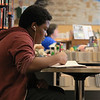 Frederick Auguste, 13, does his eighth grade math homework while hanging out in the Leominster Public Library's teen room on Tuesday afternoon. SENTINEL & ENTERPRISE/JOHN LOVE