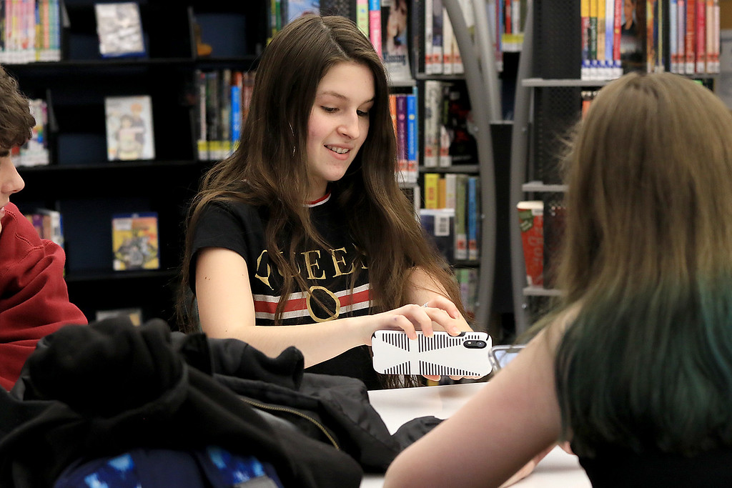 . Hanging out in the Lunenburg Public Library\'s teen room on Tuesday afternoon having fun with friends is Callie Dik, 15.  SENTINEL & ENTERPRISE/JOHN LOVE