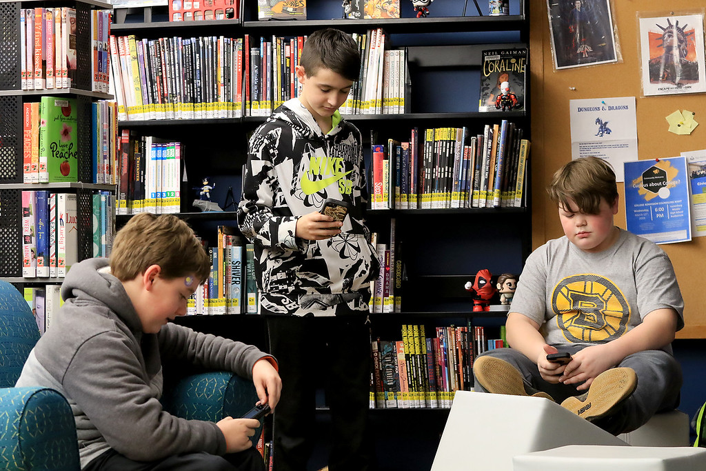 . Hanging out in the Lunenburg Public Library\'s teen room on Tuesday afternoon having fun with friends is Joseph Russo, 11, Nicholas Defelice, 12, and J.J. Abell, 11. SENTINEL & ENTERPRISE/JOHN LOVE