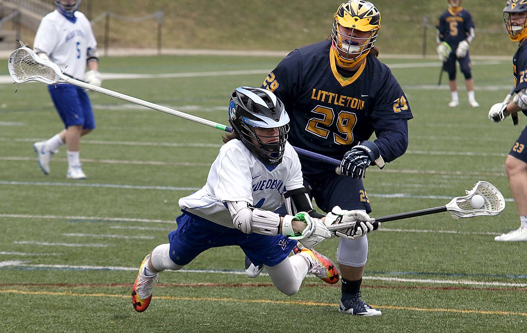 . Leominster High School boys lacrosse played Littleton High School today at Doyle Field in Leominster. Leominster Zach Jackson tries to hold onto the ball while covered by Littleton\'s Mitchell Beaudoin. SENTINEL & ENTERPRISE/JOHN LOVE