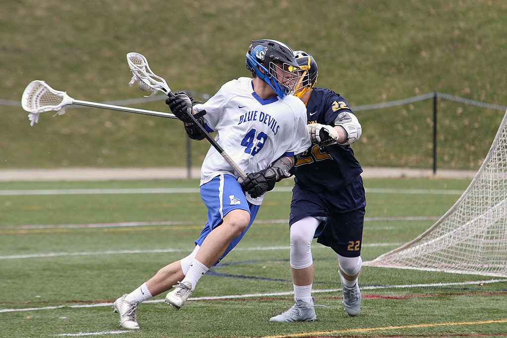 . Leominster High School boys lacrosse played Littleton High School today at Doyle Field in Leominster. Littleton\'s Adam Sundquist covers Leominster\'s Ross Howlett as he tries get to the net for a shot. SENTINEL & ENTERPRISE/JOHN LOVE