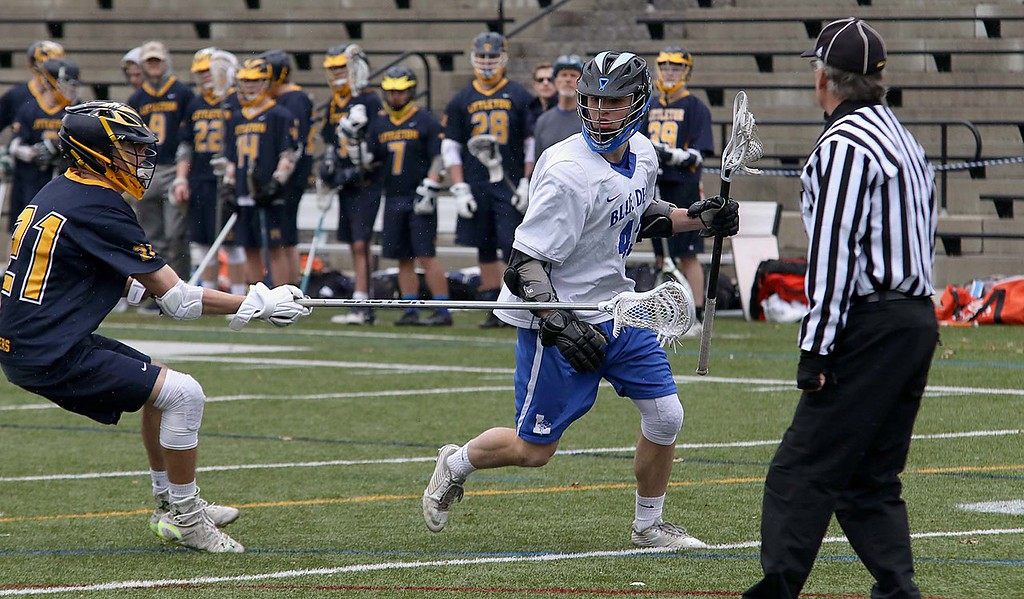 . Leominster High School boys lacrosse played Littleton High School today at Doyle Field in Leominster. Littleton\'s Ethan Dolan covers Leominster\'s Zach Jackson as he looks for an open man to pass to. SENTINEL & ENTERPRISE/JOHN LOVE