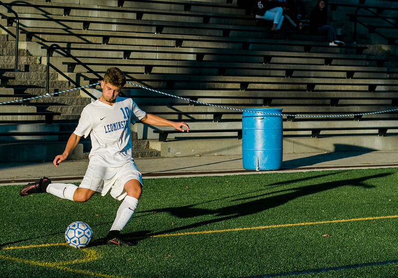 Leominster High's Nahuel Algibay puts the ball in play during the game against Shepherd Hill on Tuesday afternoon. SENTINEL & ENTERPRISE / Ashley Green