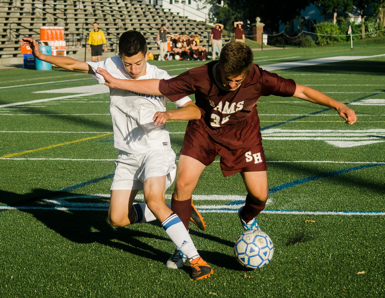 Leominster High's Andrew Sanchez and Shepherd Hill's Jacob Barrows battle for possession on Tuesday afternoon. SENTINEL & ENTERPRISE / Ashley Green