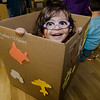 Eliana Lara pops out of her cardboard car during the drive-in movie at Leominster City Hall on Thursday, February 23, 2017. Children were able to come in and design their own box car and enjoy pizza and snacks while watching 'Zootopia' on a large projector screen. SENTINEL & ENTERPRISE / Ashley Green