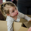 Madison Alia, 3, pops out of her cardboard car during the drive-in movie at Leominster City Hall on Thursday, February 23, 2017. Children were able to come in and design their own box car and enjoy pizza and snacks while watching 'Zootopia' on a large projector screen. SENTINEL & ENTERPRISE / Ashley Green