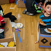 Adriel Rodriguez, 4, and brother Giovanny, 5, enjoy some pizza in their cardboard cars during the drive-in movie night at Leominster City Hall on Thursday, February 23, 2017. Children were able to come in and design their own box car and enjoy pizza and snacks while watching 'Zootopia' on a large projector screen. SENTINEL & ENTERPRISE / Ashley Green