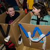 Natalie MacMillan, 12, and Shania Maillet, 10, pile in their cardboard cars during the drive-in movie night at Leominster City Hall on Thursday, February 23, 2017. Children were able to come in and design their own box car and enjoy pizza and snacks while watching 'Zootopia' on a large projector screen. SENTINEL & ENTERPRISE / Ashley Green