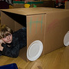 Jack Monahan pile gets cozy in his cardboard car during the drive-in movie night at Leominster City Hall on Thursday, February 23, 2017. Children were able to come in and design their own box car and enjoy pizza and snacks while watching 'Zootopia' on a large projector screen. SENTINEL & ENTERPRISE / Ashley Green